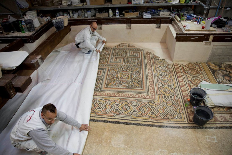 Restoration experts work on a mosaic inside the Church of the Nativity, built atop the site where Christians believe Jesus Christ was born. (Haaretz)