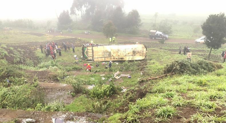 Mbukinya bus full of passengers rolls off the Kinungi black spo
