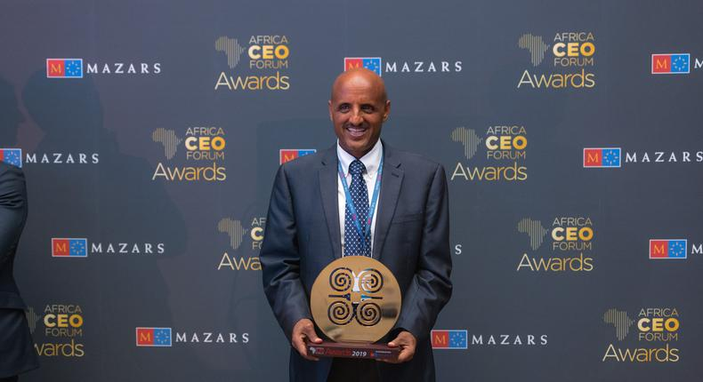 Tewolde Gebremariam CEO, ETHIOPIAN AIRLINES posing with the award at the Africa CEO Forum 2019