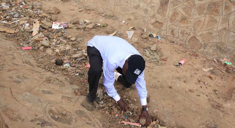 Former Kakamega Senator Bonny Khalwale collecting stones