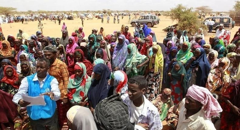 Displaced people wait to receive for non-food items from the United Nations High Commissioner for Refugees at the Kabasa transit centre for the internally displaced people in Dollow town, along the Somalia-Ethiopia border, August 30, 2011. REUTERS/Thomas Mukoya