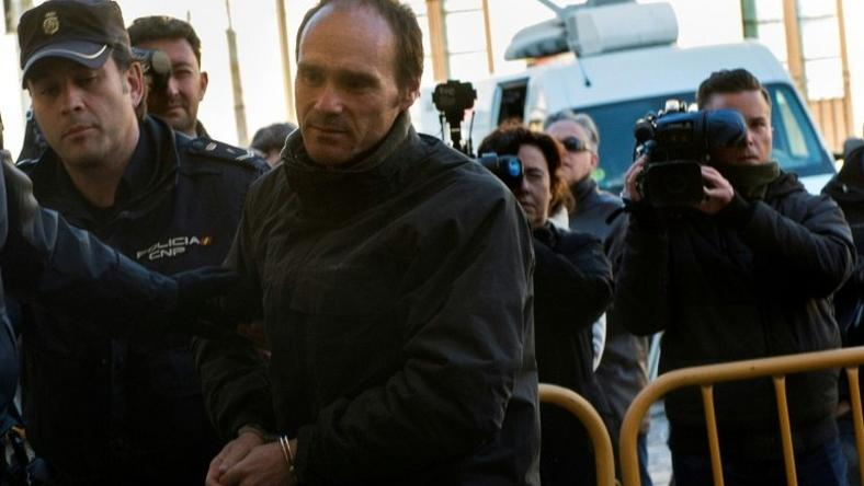 Miguel Angel Munoz (C) arrives at the provincial court of Leon, north of Spain, to be tried for the murder of a US tourist in 2015, on March 14, 2017