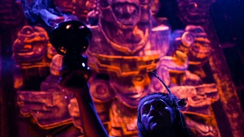 "Actors perfom in front of an altar dedicated to the underworld at the ""Gran Ofrenda"" (Mega Offering) installed in the Chapultepec Forest in Mexico City, for Day of the Dead"