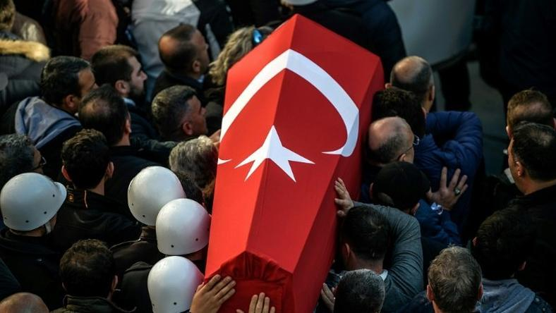 Turkish police carry the coffin of a fellow officer during a funeral ceremony at Istanbul's police headquarters on December 11, 2016