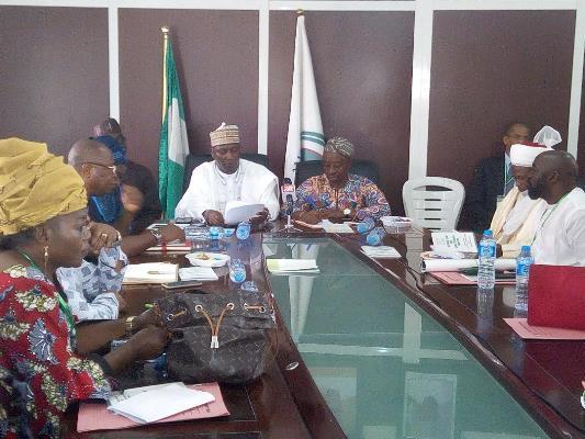 Adedayo Thomas,Executive Director, NFVCB, the Board Chairman,Tunde Kelani (R), other members of the Board at a meeting in Abuja, on Friday, March 2, 2018.