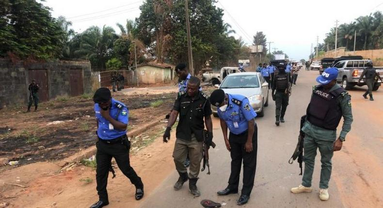 Police comb an area after unknown gunmen kill police personnel in Anambra (NAN)