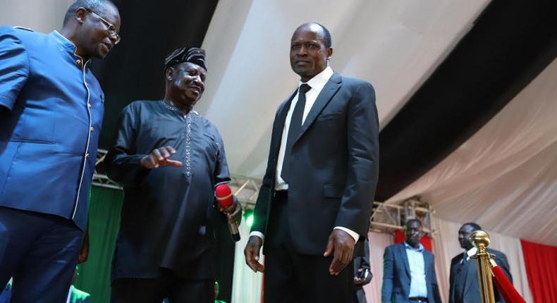 File image of Ochillo Ayacko with Raila Odinga and Okoth Obado
