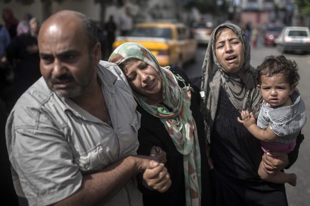 W izraelskich nalotach zginęło już ponad 300 Palestyńczyków EPA/OLIVER WEIKEN