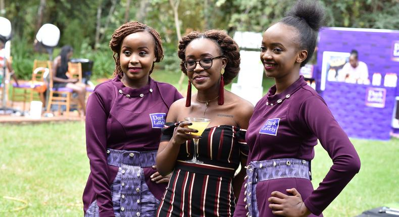 Ladies pose for a photo at the Dark and lovely 'own your crown' event