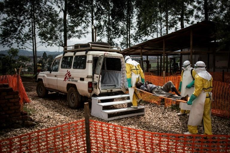 Health workers move a patient to a hospital after he was cleared of having Ebola at a Doctors Without Borders supported treatment center in Butembo, DRC in November 2018