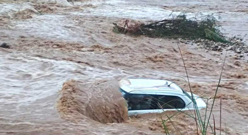 Vehicle swept away by floods