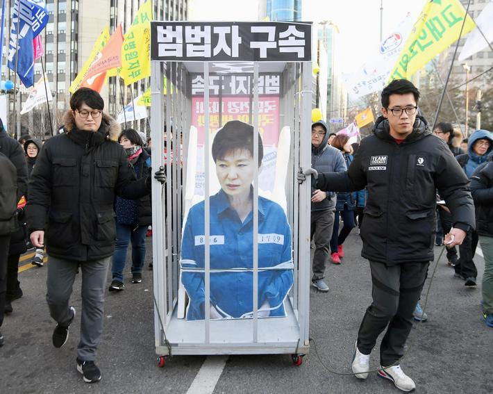 S. Koreans call for Park to step down following impeachment motion