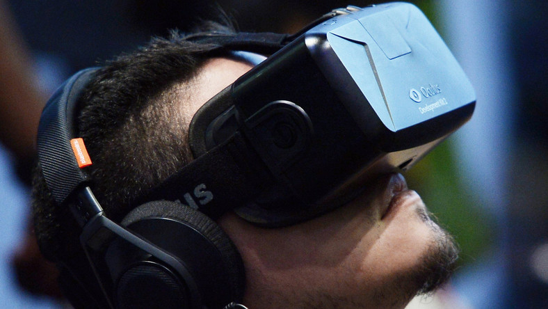 An attendee tries on the Oculus VR Inc. Rift Development Kit 2 headset at E3 in Los Angeles