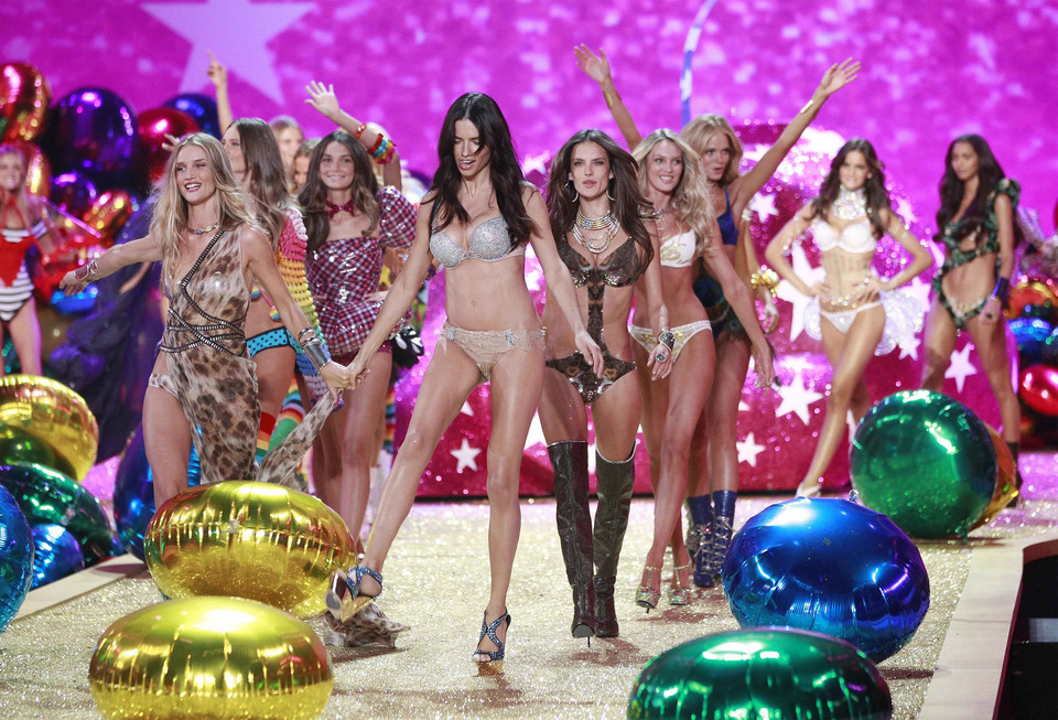 Model Adriana Lima celebrates on stage with other models after the Victoria's Secret Fashion Show at the Lexington Armory in New York