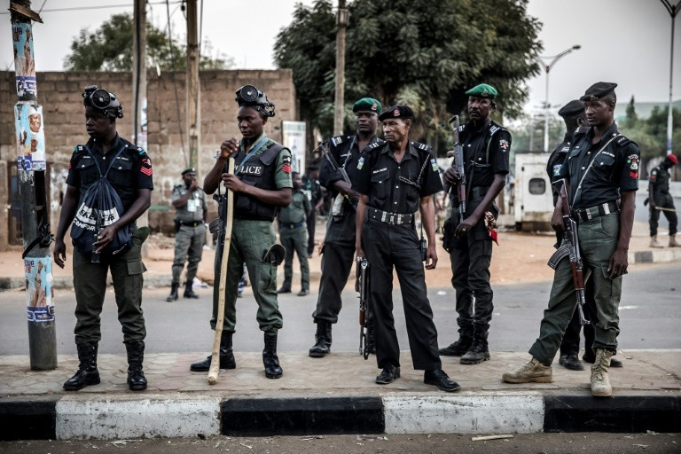Police officers stationed to keep the peace in Nigeria (Guardian)