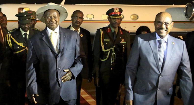 Sudan's President Omar al-Bashir welcomes Uganda's President Yoweri Museveni at Khartoum Airport for talks during an official visit to Sudan.