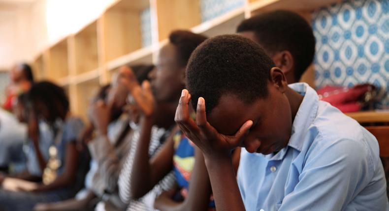 Burundian refugee school girls cry as they listen to Pakistani Nobel Peace Prize laureate Malala at the Mahama refugee camp, Rwanda.
