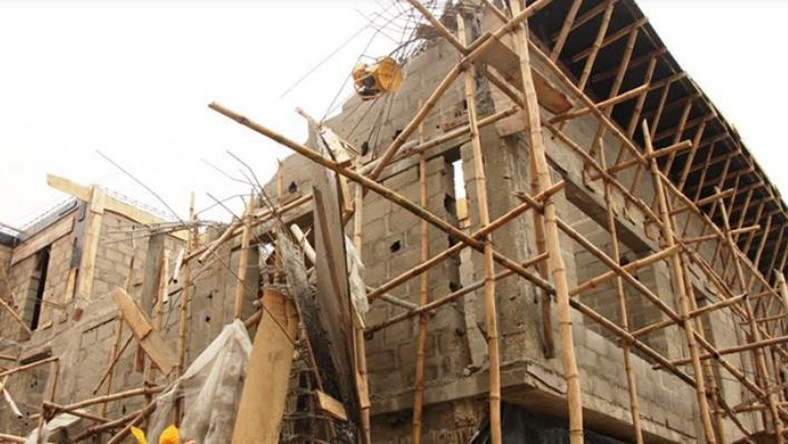 The three-storey bulding under construction collapsed on Saturday morning in Delta state.  (Punch)