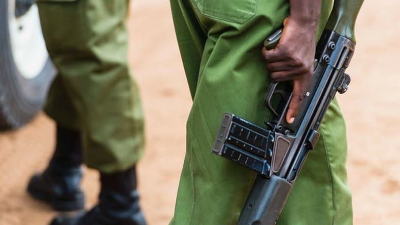A Kenyan police officer holding a gun (Courtesy)