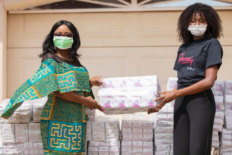 The Minister for Gender, Children and Social Protection, Mrs Cynthia Morrison receiving 2000 'Sincerely' sanitary pads from Ruth Quarshie, a representative of Sincerely Ghana Limited