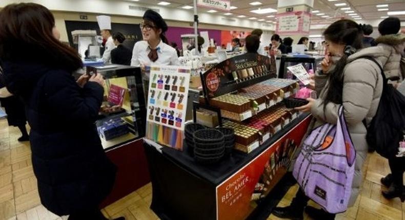Women in Japan mark Valentine's Day by buying so-called 'obligation chocolate' for boyfriends, husbands, colleagues and bosses