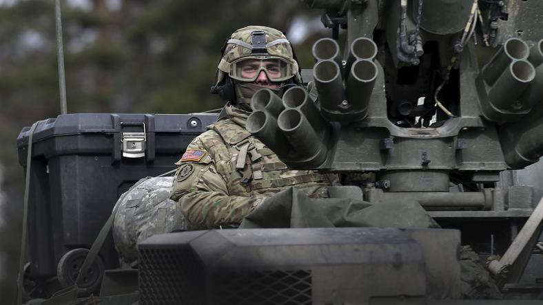 "A soldier of the U.S. Army 2nd Cavalry Regiment deployed in Estonia, as a part of the U.S. military's Operation Atlantic Resolve, looks on during the ""Dragoon Ride"" exercise near Liepupe"