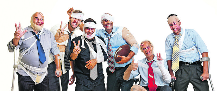 stock-photo-group-of-injured-businessmen-after-a-rugby-game-84727354