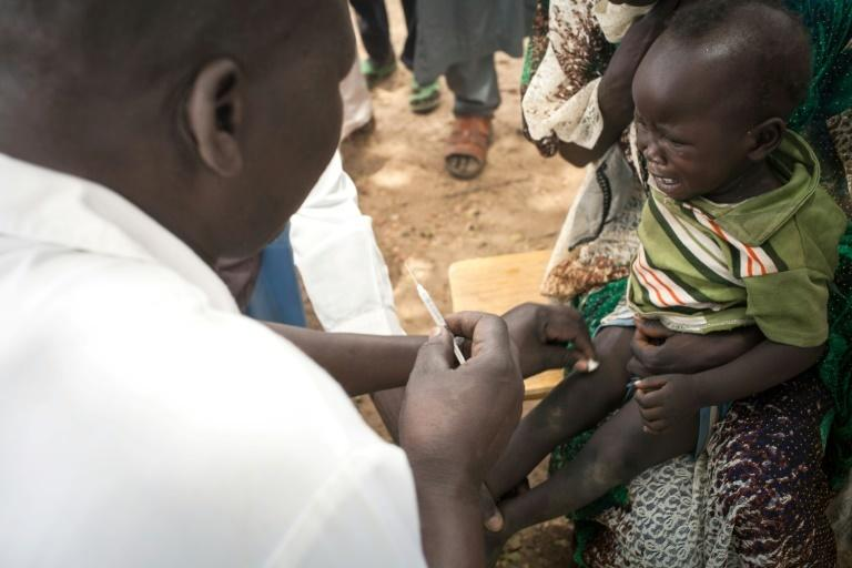 Life-saving: A child in Agang village gets the measles, mumps and rubella vaccine