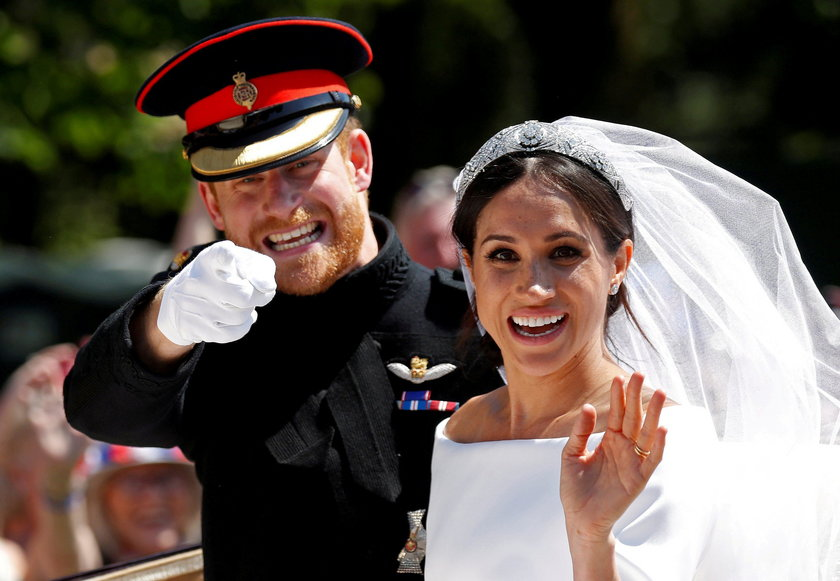FILE PHOTO: Britain's Prince Harry and Meghan, Duchess of Sussex, arrive to greet members of the pub