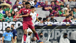 Qatar's Homam Ahmed, left, battles for a header with El Salvador's Bryan Tamacas during the Concacaf Gold Cup quarter-final match in Arizona Creator: Frederic J. BROWN