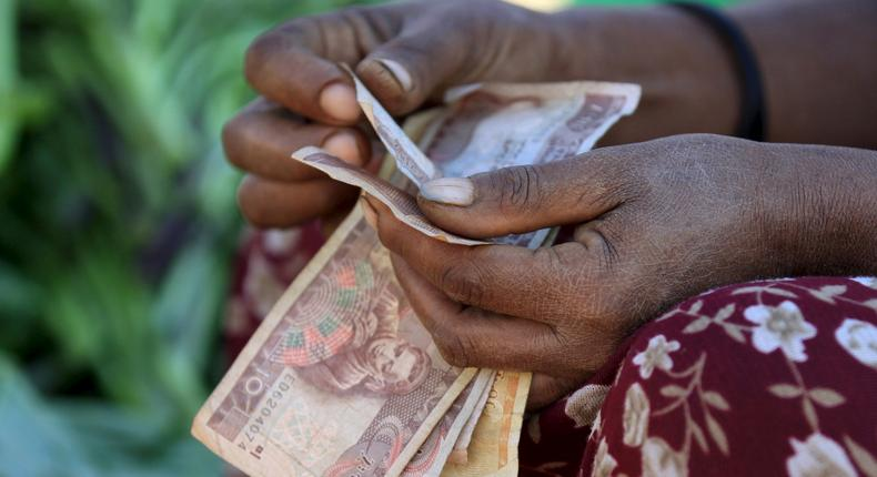 A woman counts Ethiopian birr notes ( REUTERS/Tiksa Negeri)