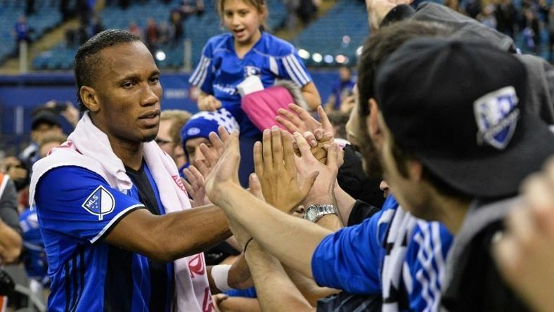 Didier Drogba of the Montreal Impact celebrates with fans during leg one of the MLS Eastern Conference finals against the Toronto FC at Olympic Stadium on November 22, 2016 in Montreal, Quebec, Canada