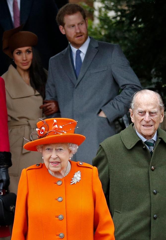 Megan sa Harijem i kraljicom Elizanetom II i princom Filipom