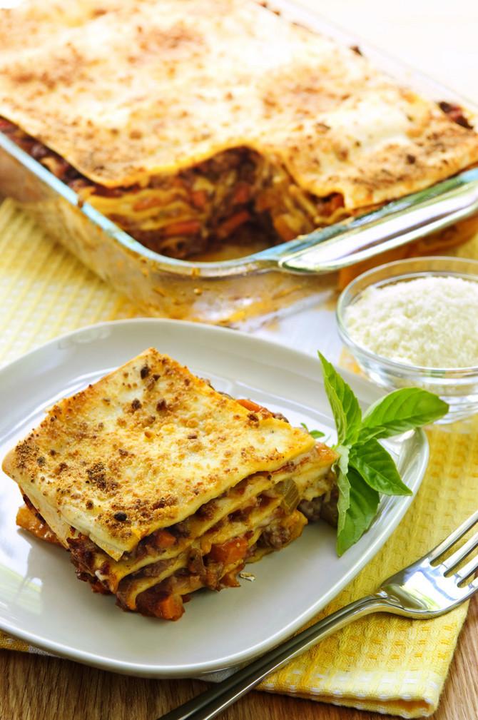 5040_stock-photo-fresh-baked-lasagna-casserole-with-a-serving-cut-shutterstock_35749174