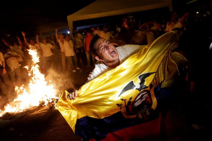 Supporters of Ecuadorean presidential candidate Guillermo Lasso demonstrate in Guayaquil during a na