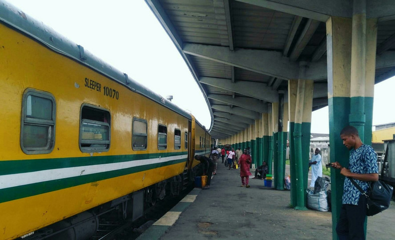 Commuters wait to board a train Nigeria (Punch)