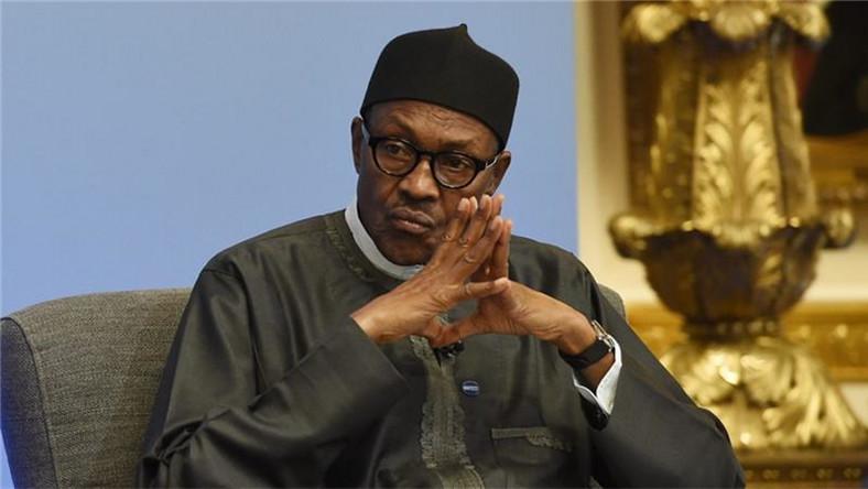 President Muhammadu Buhari appears to be looking sad (Guardian)