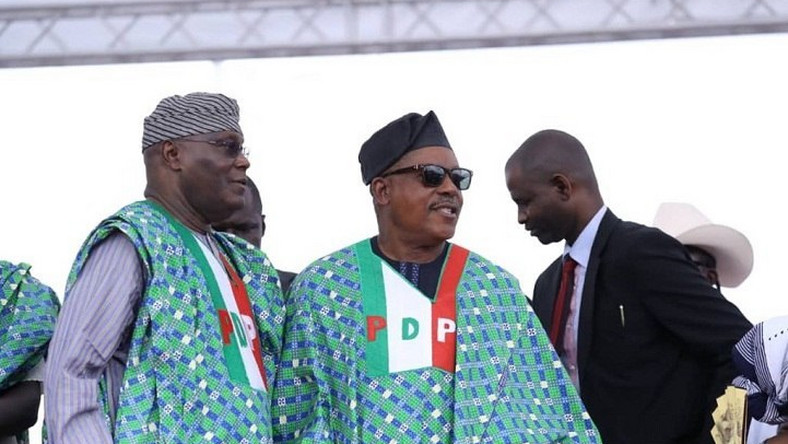 Former vice president, Atiku Abubakar, with the PDP's national chairman, Uche Secondus [Punch]