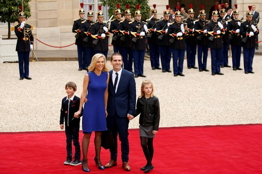 Laurence Auziere Jourdan, daughter of Brigitte Trogneux, and her husband Guillaume arrive to attend