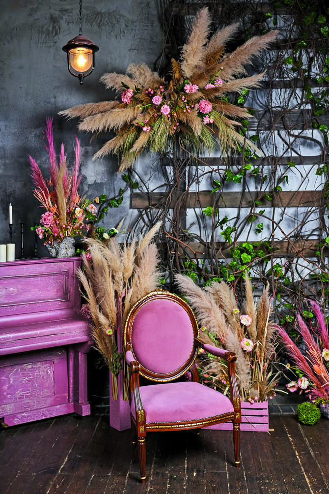 s stock-photo-boho-style-area-decorated-with-flower-arrangements-and-pampas-grass-pink-armchair-and-pink-piano-1878673624