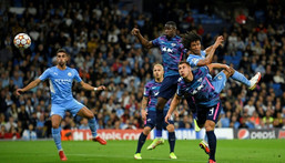 Tinged with sadness: Manchester City's Dutch defender Nathan Ake  jumps to head the ball home Creator: Oli SCARFF