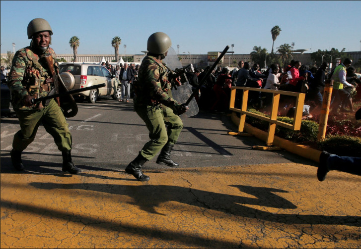 GSU officers in running battles with passengers and striking workers at the JKIA in Nairobi .
