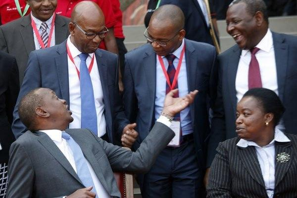 President Uhuru Kenyatta talks to Safaricom CEO Bob Collymore (left), KCB Group CEO Joshua Oigara (centre), Equity Bank CEO James Mwangi