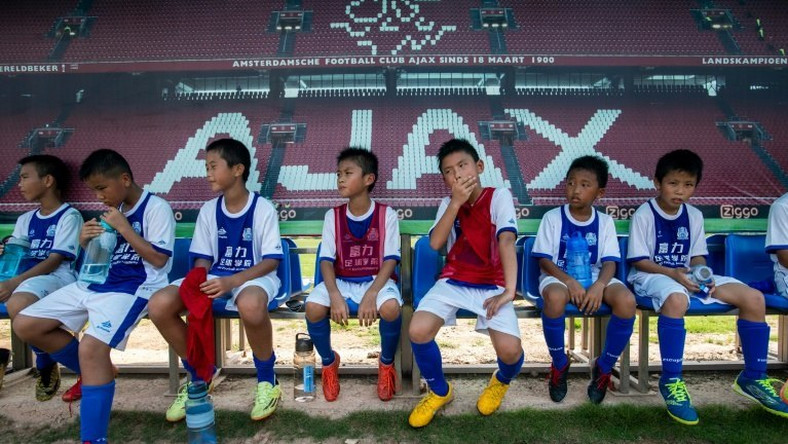 Children rest after a training session at the Guangzhou R&F Football Academy in Meizhou in southern China