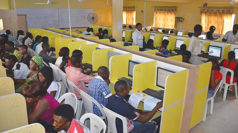 Nigerians checking their Joint Admissions and Matriculation Board (JAMB) results. (Premium Times)