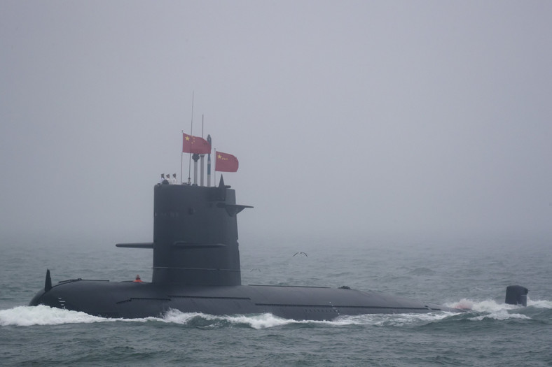 A Great Wall 236 submarine of the Chinese People's Liberation Army (PLA) Navy, billed by Chinese state media as a new type of conventional submarine, participates in a naval parade to commemorate the 70th anniversary of the founding of China's PLA Navy in the sea near Qingdao in eastern China's Shandong province, Tuesday, April 23, 2019.
