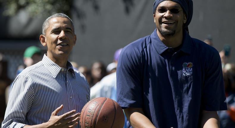 President Barack Obama and former NBA basketball player Etan Thomas playing basketball.