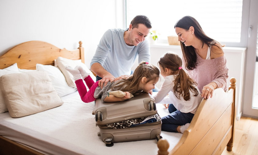 Young family with two children packing for holiday.