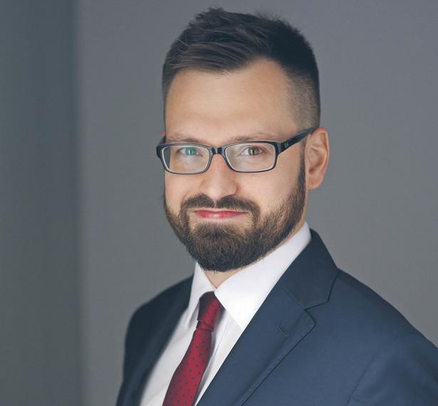 dr Michał Mostowik, adwokat i starszy prawnik w kancelarii DLK Legal