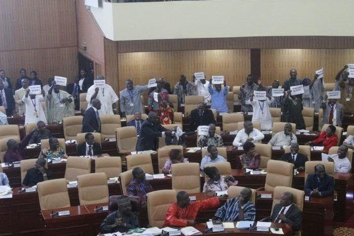 "The minority members carrying sheets of papers with the inscription ""dead goat budget"" immediately after Mr. Seth Terkper, the Finance Minister,  concluded his delivery."